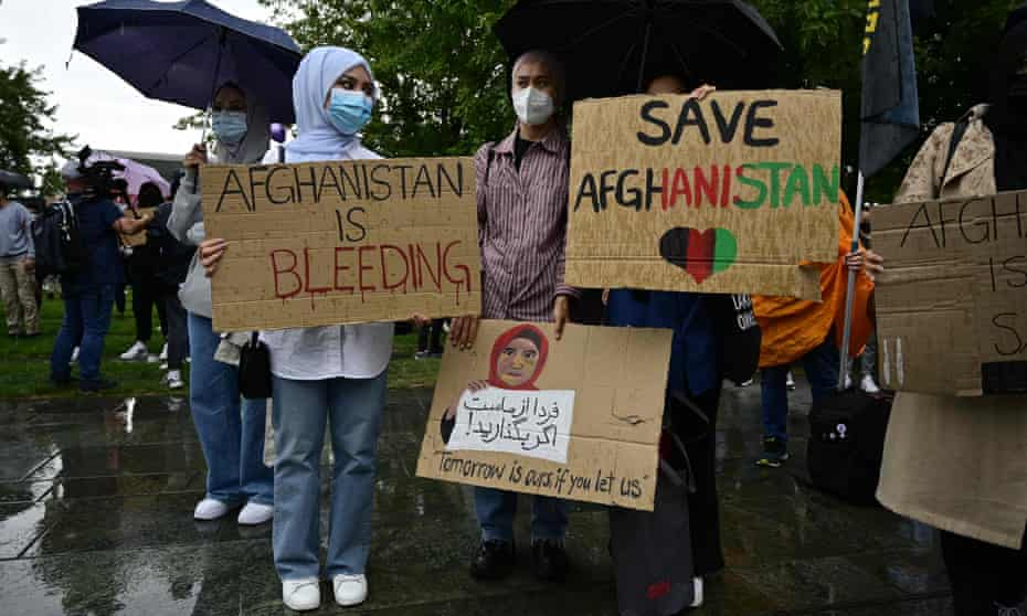 Protesters display placards in support of Afghan people in front of the chancellery in Berlin on Sunday.