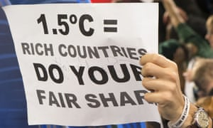 A poster calling for a 1.5C goal at the Paris climate talks