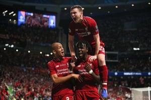 Divock Origi of Liverpool celebrates after scoring a goal to make it 0-2