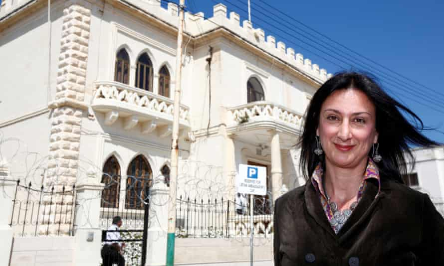 Daphne Caruana Galizia outside the Libyan embassy in Valletta, Malta, in 2011. Organised crime, particularly oil smuggling from Libya, was a frequent subject for her investigations.