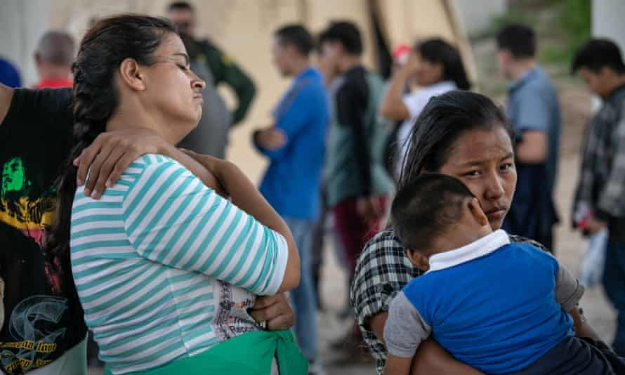 Immigrants seeking asylum are taken into custody by border patrol agents in McAllen, Texas.