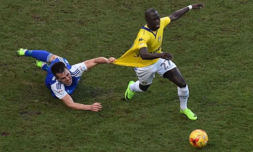 Jonas Knudsen pulls at the shirt of Leeds' Mo Barrow, the on-loan Swansea City winger.