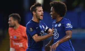 Willian of Chelsea celebrates with teammate Cesar Azpilicueta after scoring his team's second goal.