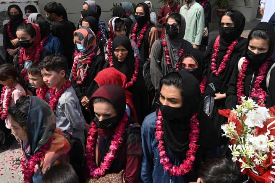 Members of Afghanistan's national girls football team arrive in Lahore earlier on Wednesday.