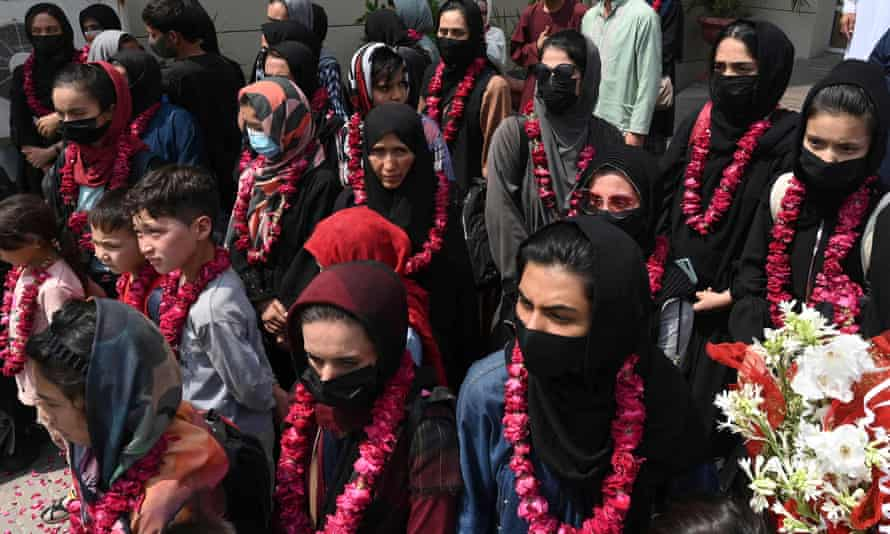 Female footballers from Afghanistan and family members arrive at the Pakistan football federation's headquarters in Lahore on Wednesday.