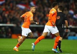 Depay celebrates after scoring the equaliser for the Netherlands.