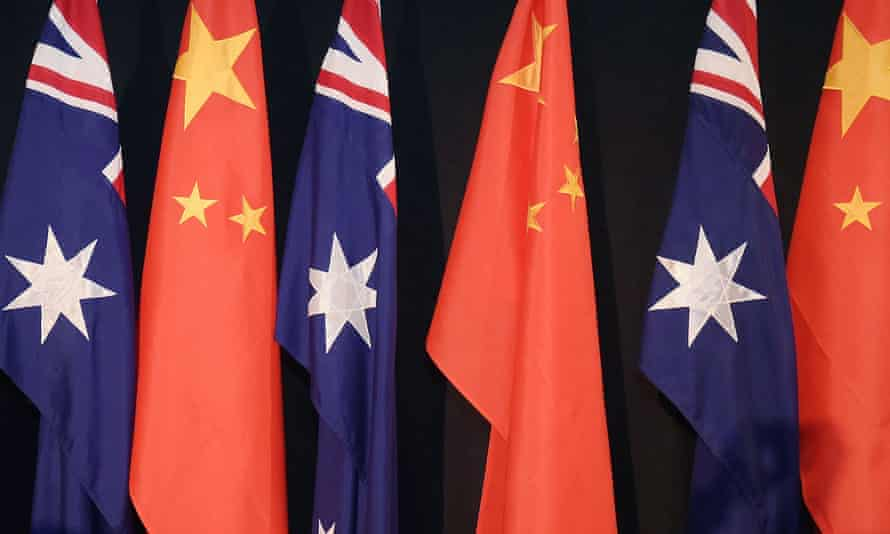 A row of Australian and Chinese flags