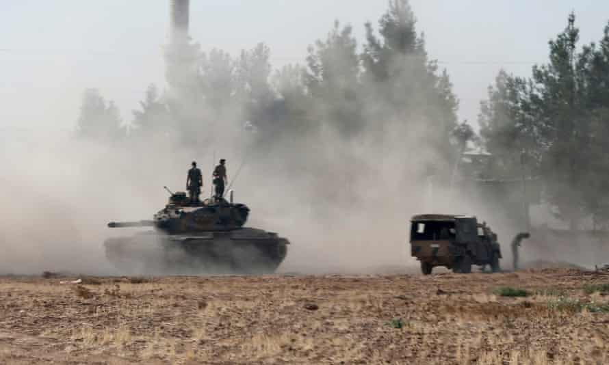 A Turkish army tank and an armoured vehicle in Karkamus, near the border with Syria.