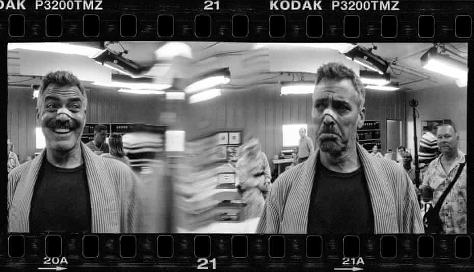 """'As the shot is exposing, I shout """"shift!""""' … Clooney on the set of the 2009 film."""