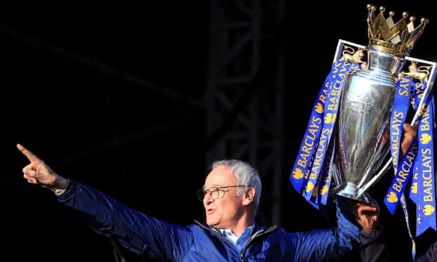 Claudio Ranieri shows off the Premier League title in Leicester city centre last May.