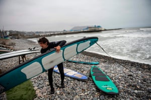 A surfing instructor at Punta Roquitas beach, in the Miraflores district of Peru