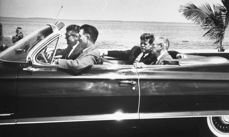John F Kennedy (rear of car, left) with Harold Macmillan in Florida in 1961.