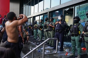 Police officers guard the CNN Center during a protest in Atlanta.