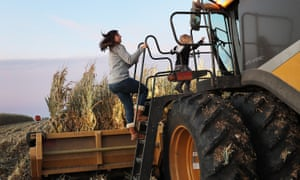 Iowa: First Battleground State In The Presidential Election<br>BAXTER, IOWA - OCTOBER 12: Ashley Schnieders and Arabelle Schnieders,3, join Troy Koehler as he drives a combine during the corn harvest in a field at the Hansen Family Farms on October 12, 2019 in Baxter, Iowa. The 2020 Iowa Democratic caucuses will take place on February 3, 2020, making it the first nominating contest in the Democratic Party presidential primaries. (Photo by Joe Raedle/Getty Images)