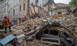 Firefighters remove rubble at the site where two buildings collapsed on Monday in Marseille, southern France