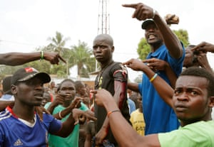 An angry crowd parades a man wounded as regional peacekeepers tried to evacuate Muslim clerics from a in Bangui, Central African Republic, in 2013.