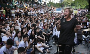 Denise Ho performs during a free concert in Hong Kong after cosmetics giant Lancome cancelled a concert featuring the local singer who is critical of China.