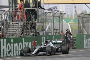 Mercedes driver Lewis Hamilton of Britain drives past the checkered flag to win the Chinese Formula One Grand Prix at the Shanghai International Circuit in Shanghai.