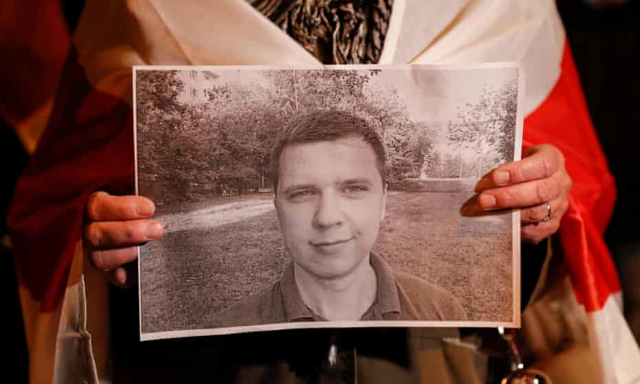 Person holds photo of Andrei Zeltser