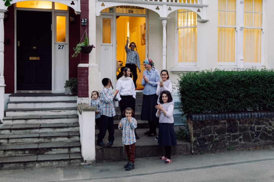 Mrs Shisha and her family clap for the NHS and key workers on their street in Stamford Hill