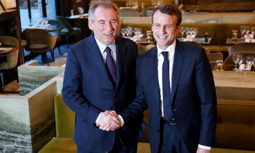 Emmanuel Macron shakes hands with Francois Bayrou