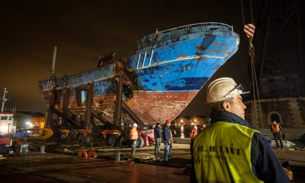 The wreck of the boat is hauled into position at the Arsenale at the Venice Biennale
