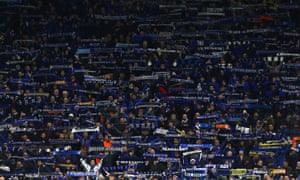 Atalanta fans show their support during the Uefa Champions League match against Valencia at Milan's San Siro Stadium on 19 February