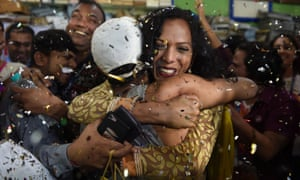 People celebrate the Indian supreme court decision to strike down a colonial-era ban on homosexual sex