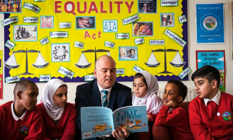 Assistant headteacher Andrew Moffat with pupils at Parkfield community school in Birmingham.