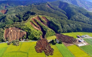 An aerial photo shows the aftermath of a large landslide in Atsuma, Japan