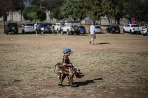 A child wearing a rhino costume attends a demonstration at the opening of the Convention on International Trade in Endangered Species of Wild Fauna and Flora