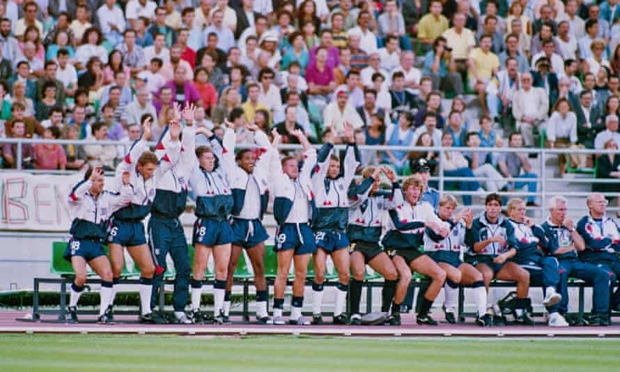 England players on the subs bench perform a Mexican Wave during the 1990 World Cup third place playoff. Left to right: Steve Hodge, Terry Butcher, Chris Waddle, John Barnes, Paul Gazza Gascoigne, Steve Bull, Chris Woods, Dave Beasant, Stuart Pearce and Neil Webb.