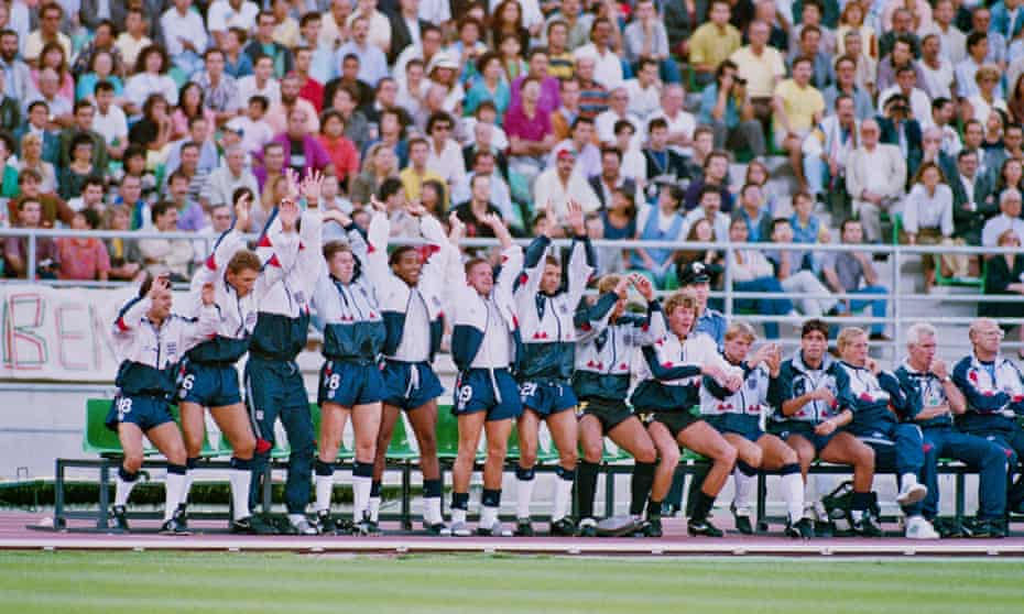 England players on the substitutes bench perform a Mexican Wave during the 1990 World Cup third-place tie. From left to right: Steve Hodge, Terry Butcher, Chris Waddle, John Barnes, Paul Gazza Gascoigne, Steve Bull, Chris Woods, Dave Beasant, Stuart Pearce, and Neil Webb.