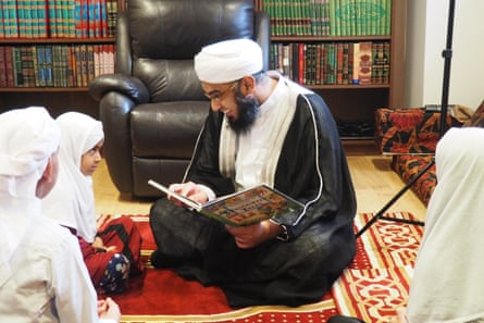 Mufti Zeeyad Ravat giving a lesson to his children during Ramadan from his home in Dandenong.