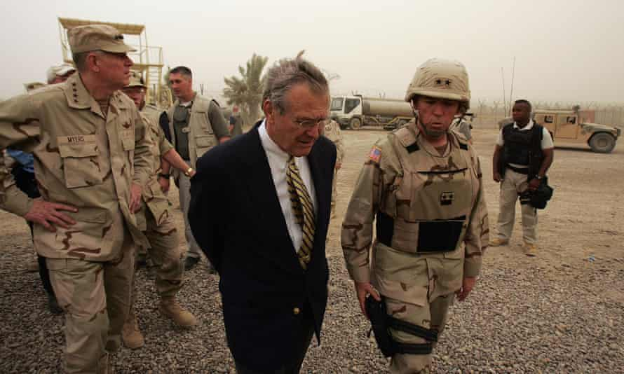 Donald Rumsfeld on a tour of the Abu Ghraib prison prison outside Baghdad in 2004.