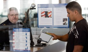 A Customs and Border Protection officer works at George Bush intercontinental airport in Houston, where Henry Rousso was detained.