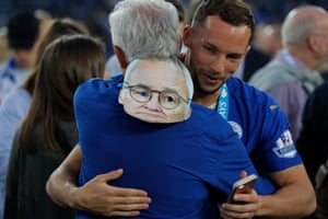 Danny Drinkwater celebrates with a member of Leicester's backroom staff