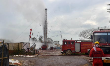 An Oil India Limited (OIL) firefighter oversees the oil well site following the 27 May blast at the Baghjan oil field.