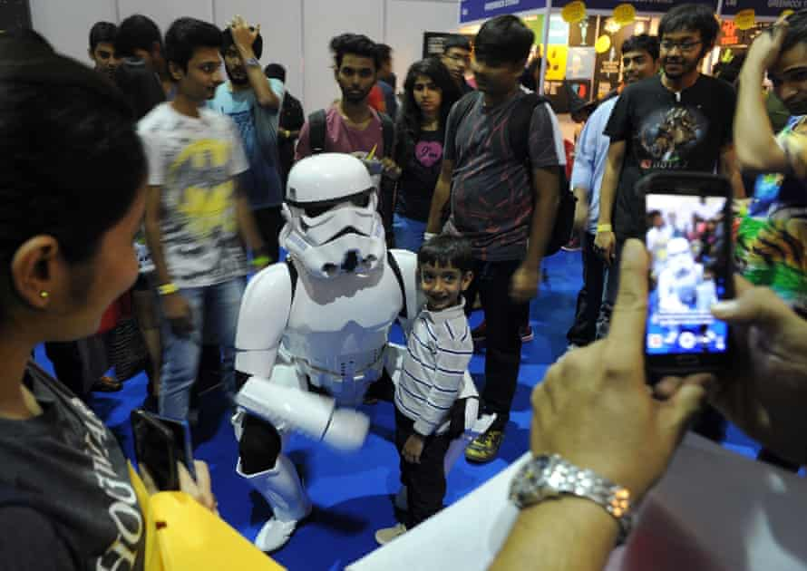 A young Indian Star Wars fan gets a photograph with a Stormtrooper at Mumbai Comic Con.