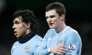 Adam Johnson with Carlos Tevez during their time at Manchester City
