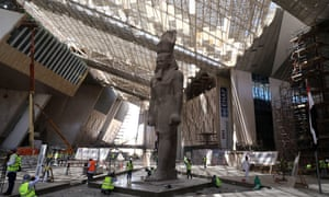 Builders work around the Ramses II statue at the Grand Egyptian Museum, Giza, Cairo, Egypt.