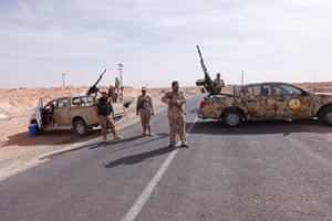 Libyan army forces form a checkpoint outside the city of Bani Walid, October 2012.