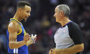 Stephen Curry talks with referee Scott Wall during the first half against the Memphis Grizzlies.