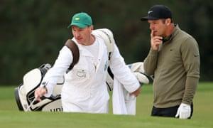 Paul Casey of England talks with his caddie John McLaren.