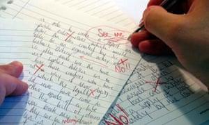 A teacher marking an exam paper