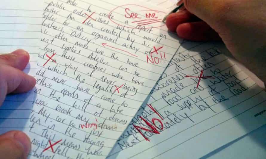 A teacher marking a poor exam paper