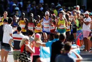 Callum Hawkins of Scotland and Liam Adams of Australia lead the pack during the men's marathon final.