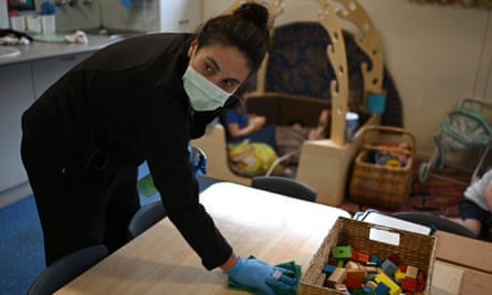 Early childhood educator Josephine wipes down tables and bench tops with disinfectant at the Robertson Street Kindy Childcare Centre in Helensburgh south of Sydney, 3 April 2020.