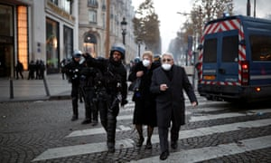 A policeman helps passers-by to avoid the trouble in Paris