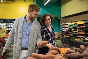 Emily Holden and her boyfriend, Adam Aton, at the Whole Foods in their neighborhood in Washington DC.
